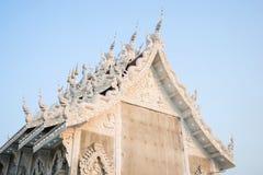 Thai art on temple roof under blue sky Stock Photos