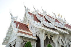 Thai art on temple roof under blue sky Stock Images