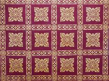 Thai art  wall paper. Thai art of wallpaper pattern in flower shape and red background Royalty Free Stock Photos