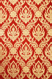 Thai Art wall red pattern deity design. royalty free stock photos