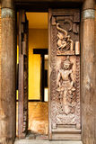 Thai art on wood door Stock Photos