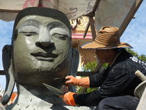 A Thai artist shapes a Buddha statue Royalty Free Stock Photo