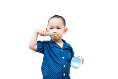 Thai baby boy brushing teeth. In baby hand holding cup Royalty Free Stock Photography
