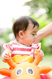 Thai baby. Cute Asia baby in sitting animal toy 'Thailand Royalty Free Stock Images