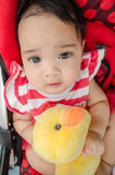 Thai baby. Cute Asia baby in sitting in children cart'Thailand Royalty Free Stock Photography