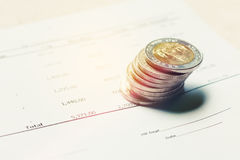 Thai baht coin on paperwork summary report with savings concept. Stock Photos