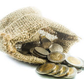 Thai baht coins in a small sack on a white background Royalty Free Stock Images