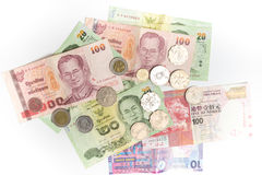 Thai baht and Hong Kong Dollars banknotes and coins isolated, currency of Thailand and Hong Kong. Thai baht and Hong Kong Dollars banknotes and coins isolated on Stock Photography