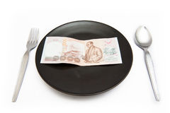 1000 That. Thai Baht 1000 That is in the plate and spoon Royalty Free Stock Images