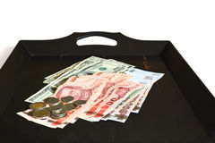 Thai bahts and US dollars Royalty Free Stock Photo