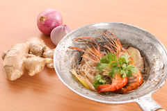 Thai baked shrimp with glass noodle on wooden background Stock Photos