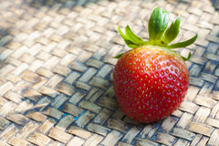 Thai bamboo handwork plate with strawberry Stock Image