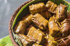 Thai bananas in Sticky Rice. Thai style dessert, made from banana and glutinous rice, wrap with banana leaf Royalty Free Stock Photos