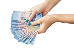 Thai Banknote money in female hand,  on white background Stock Photo