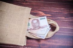 Thai banknote in sack bag Royalty Free Stock Photo
