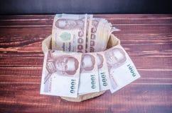 Thai banknote in sack bag Royalty Free Stock Image