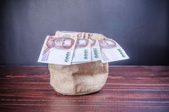 Thai banknote in sack bag Stock Images