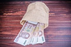 Thai banknote in sack bag Royalty Free Stock Images