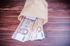 Thai banknote in sack bag Royalty Free Stock Photos