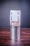 Thai banknote on silver can Stock Photo