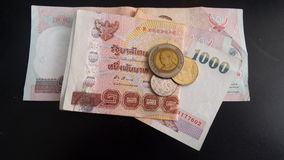 Thai banknotes and coins Royalty Free Stock Images
