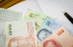 Thai banknotes and coins Royalty Free Stock Photography