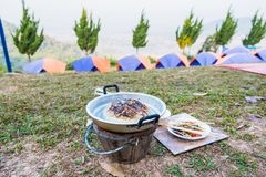 Thai barbecue Grill Pork It was yesterday& x27;s food.Camping day.Thailand. Adventure background barbeque bbq buffet campsite chopsticks cook cooked cooking stock photography