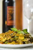 Thai Basil Curry Chicken. Vertical view of chinese style of thailand yellow curry chicken cooked with basil. showing also wine as the background royalty free stock photo