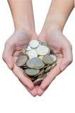 Thai bath coins in women hand Stock Photo