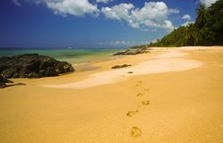 Thai beach. Sand beach on a clear day with footprints on the sand Royalty Free Stock Image