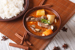 Thai beef massaman curry with peanuts and rice side dish Stock Images