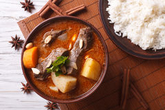 Thai beef massaman curry and rice side dish closeup. horizontal Stock Image