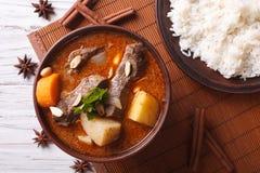 Thai beef massaman curry and rice side dish closeup. horizontal Stock Image