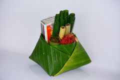 Thai belief. Offering,betel,cigarette,matches,banana leaf,chaplo, about for god to protect your house then they will offering this one Stock Photos