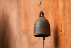 Thai bell on orange wall Stock Photos