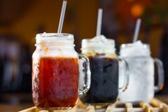 Refreshment with Thai beverages. Thai beverages, coconut juice, Thai ice tea and Thai ice coffee royalty free stock photos