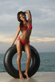 Thai Bikini Model With Tube Stock Photo