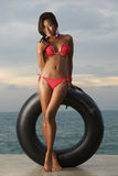 Thai Bikini Model With Tube Royalty Free Stock Photography