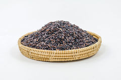 Thai black jasmine rice (Rice berry). In bamboo basket isolated on white royalty free stock photos