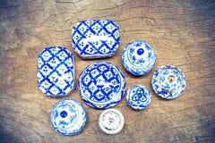 Thai blue porcelain on vintage grunge wooden background Royalty Free Stock Images