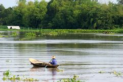 Thai boat. In flooded river royalty free stock photography