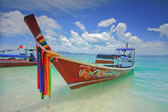 Thai boat. Docking Thai boat in island bay, south of Thailand Stock Photo
