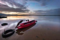 Thai boat. Fisherman boat on water at sunrise Stock Image