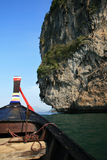 Thai boat front and cliffs Stock Photography