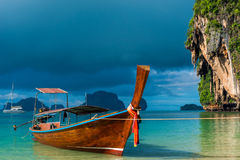 A Thai boat with a long tail near the shore Royalty Free Stock Photo