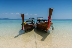 Thai boat longtail boat on the sea beach Royalty Free Stock Images