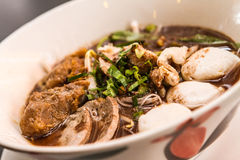 Thai boat noodle. The famous Thai boat noodle served with meatballs, pork, and liver Royalty Free Stock Images