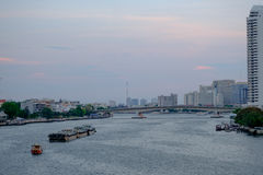 Thai boat tugboat is dragging on Chao Phraya River. Stock Image