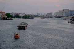 Thai boat tugboat is dragging on Chao Phraya River. Stock Photos