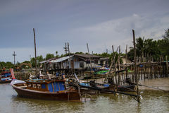 Thai boats in a paradise beach setting Stock Photography